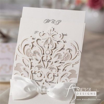 Intricate Symmetry Pocket with Ribbon laser cut wedding invitation
